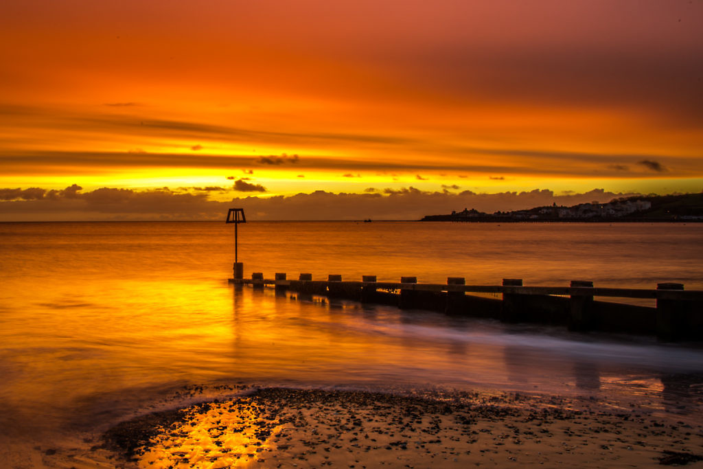Swanage Sunrise Picture with fiery Sun Rise in Swanage Bay