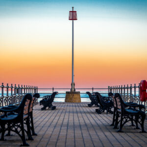 sunset banjo pier image swanage