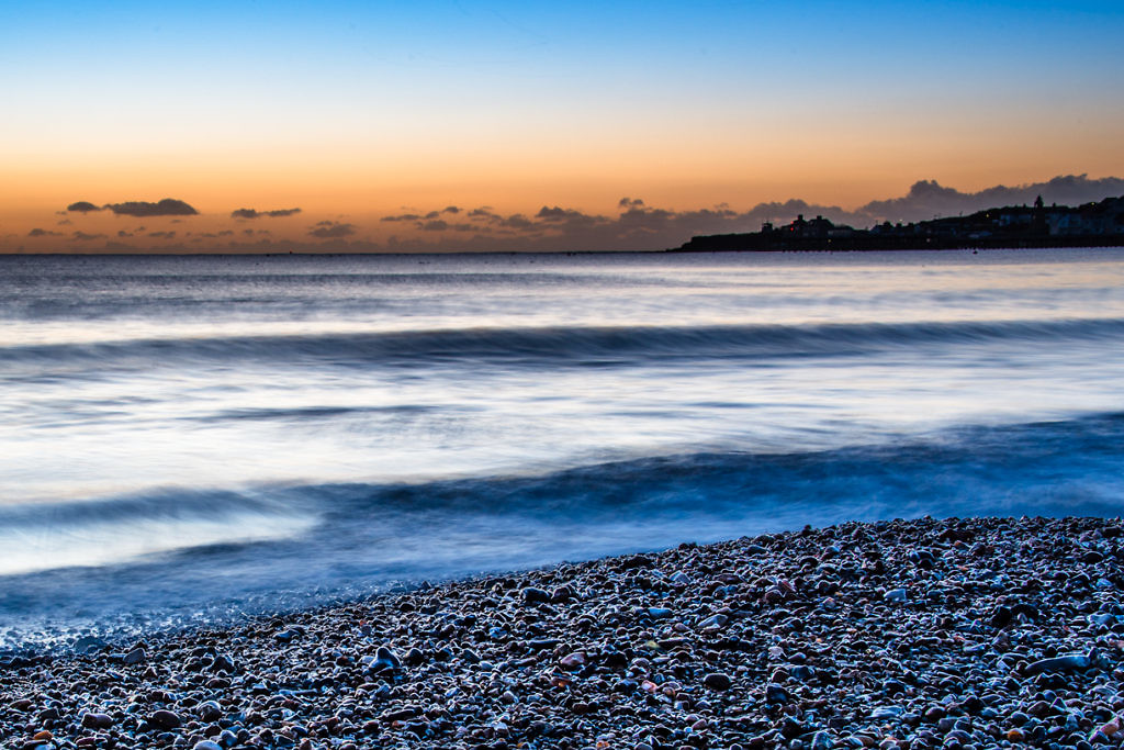 Pebble Sunrise Swanage Beach Dawn breaking at Swanage Bay