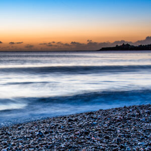 Pebble Sunrise Dawn breaking at Swanage Bay
