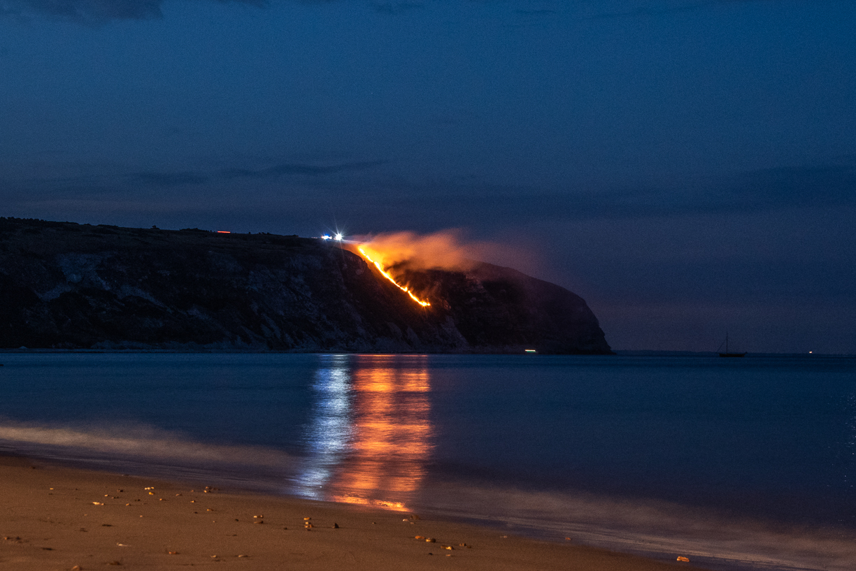 Ballard Down Fire. The Headland on fire Swanage Bay