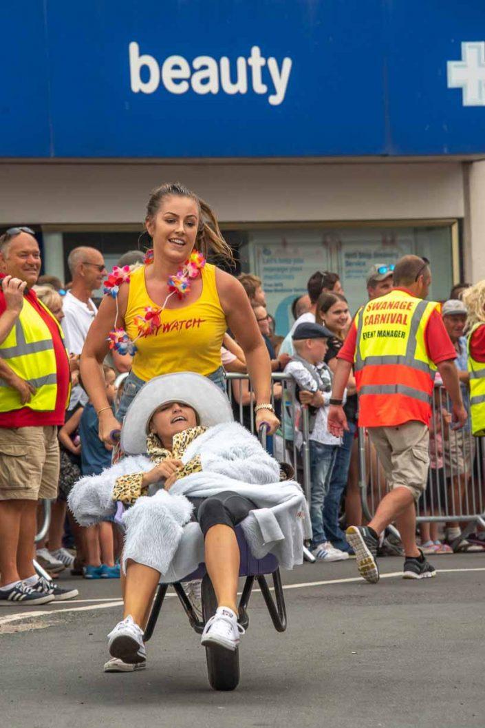 Baywatch Beauty Swanage Carnival Wheelbarrow Race