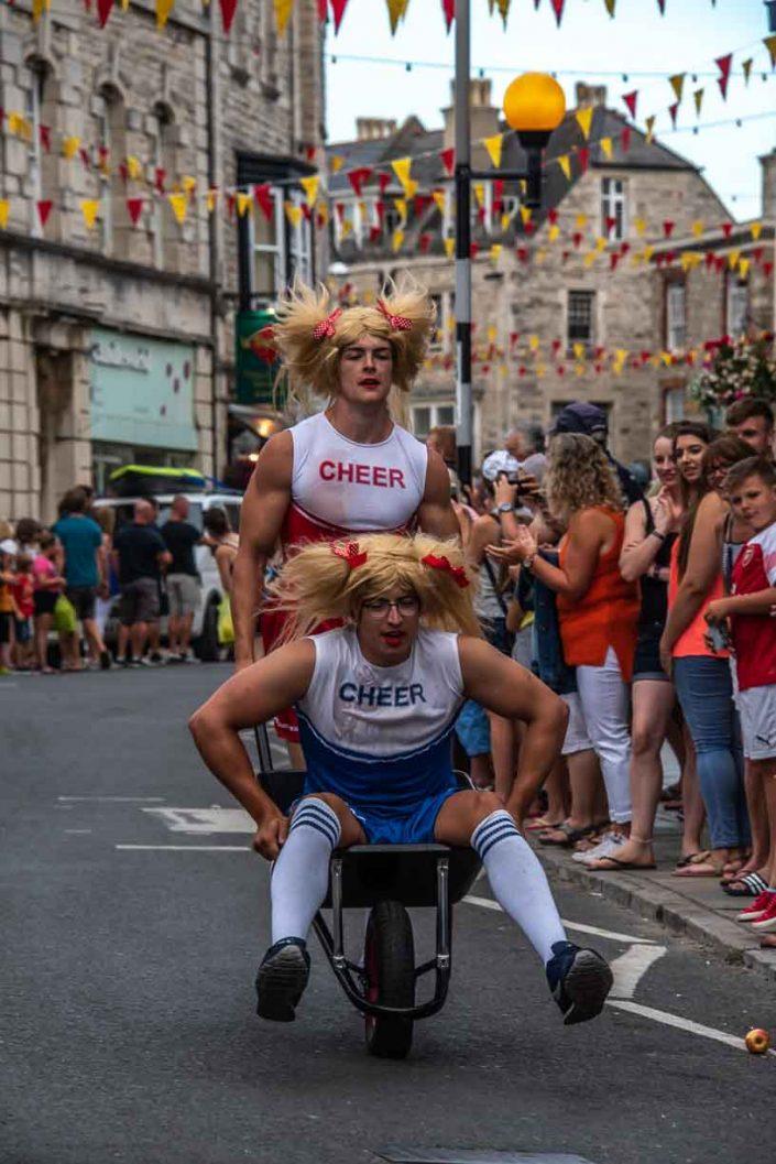 Cheer Leader Dudes Swan Pub Swanage Carnival Wheel Barrow Race Over