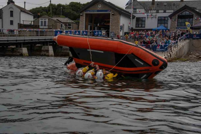 Swanage volunteer lifeboat crew demonstrate D class capsize training coming over