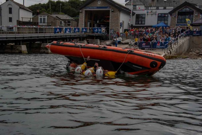 Swanage volunteer lifeboat crew demonstrate D class capsize training almost done