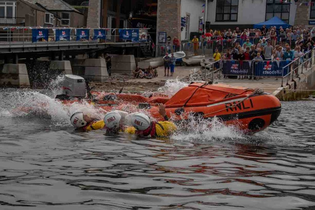 Swanage volunteer lifeboat crew demonstrate D class capsize training lifeboat righted all done
