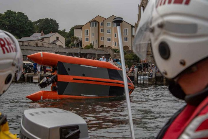 Swanage volunteer lifeboat crew demonstrate D class capsize training the capsize