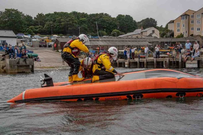 Swanage volunteer lifeboat crew demonstrate D class capsize training all onboard
