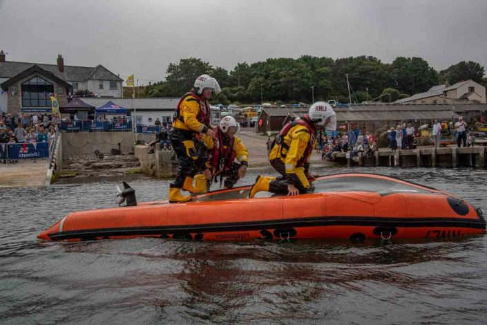Swanage volunteer lifeboat crew demonstrate D class capsize training move forward