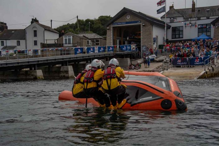 Swanage volunteer lifeboat crew demonstrate D class capsize training lean back